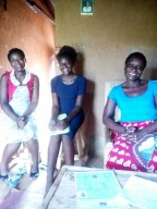 Mtisunge at home with her family