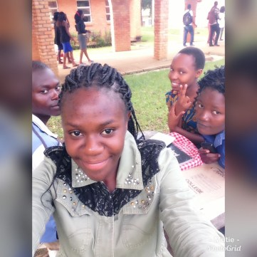 Mtisunge taking selfie with friends