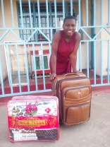 Joyce with a new suitcase and a new blanket