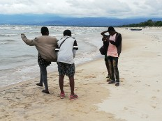 Taking pictures at Kande beach