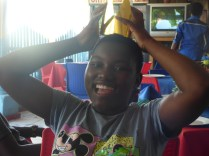 Joyce playing silly with the crown