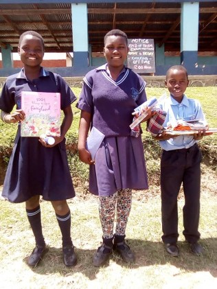 Joyce Katie and Gift with the books