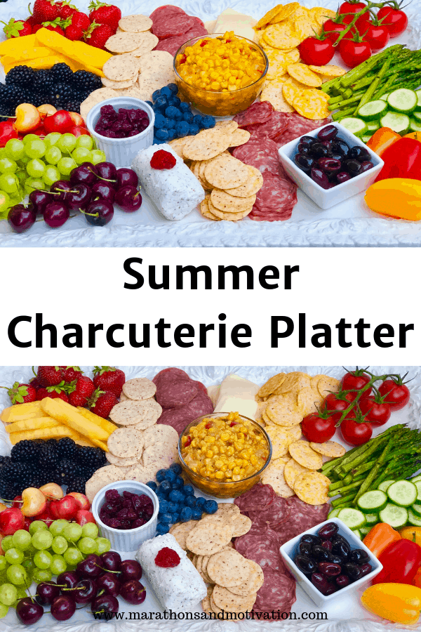 A charcuterie platter with fresh fruits, vegetables, and cured meats