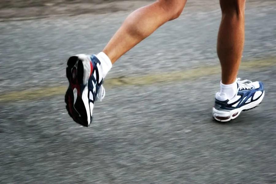 feet of a running woman
