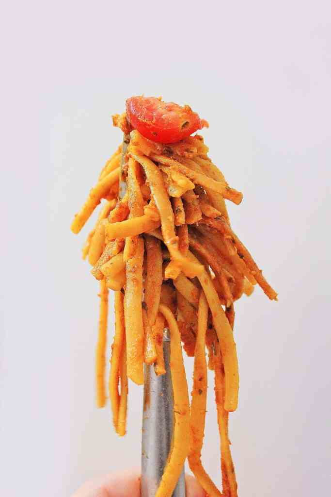 Pasta Puttanesca on a fork