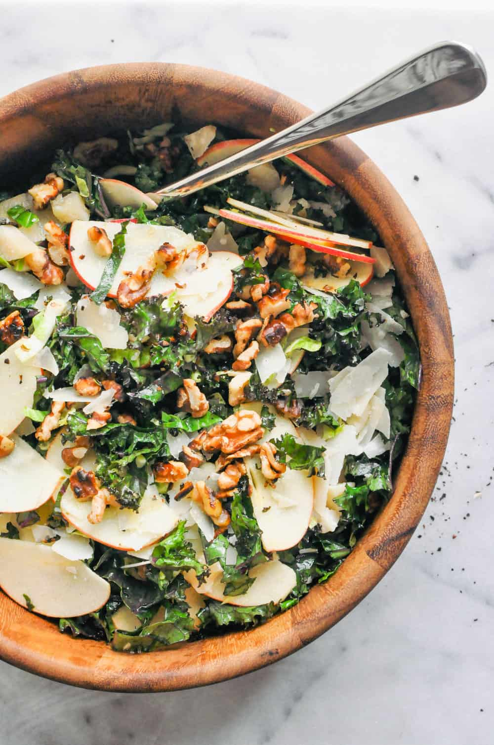 Shredded Brussels Sprouts, Kale and Apple Salad in a wooden bowl