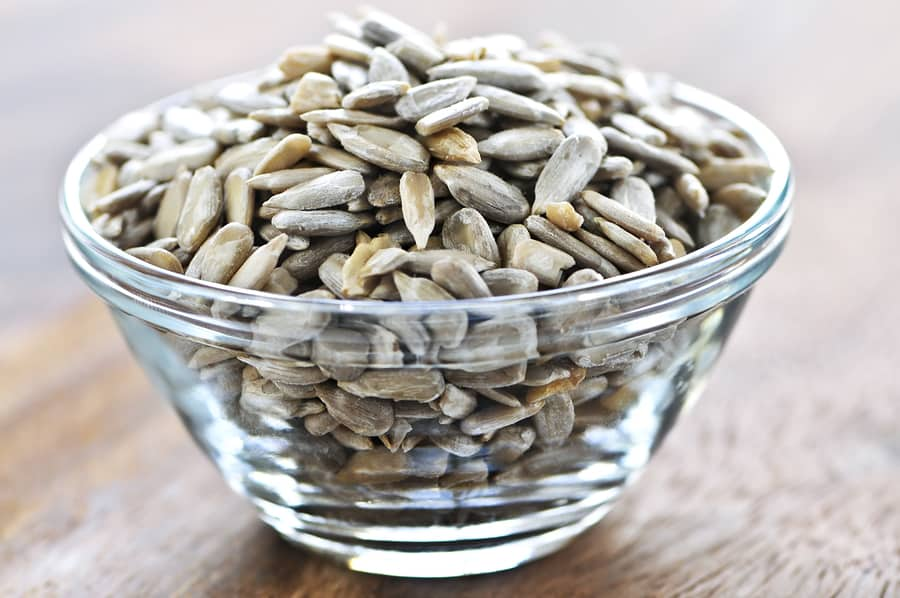 Shelled sunflower seeds close up in glass bowl