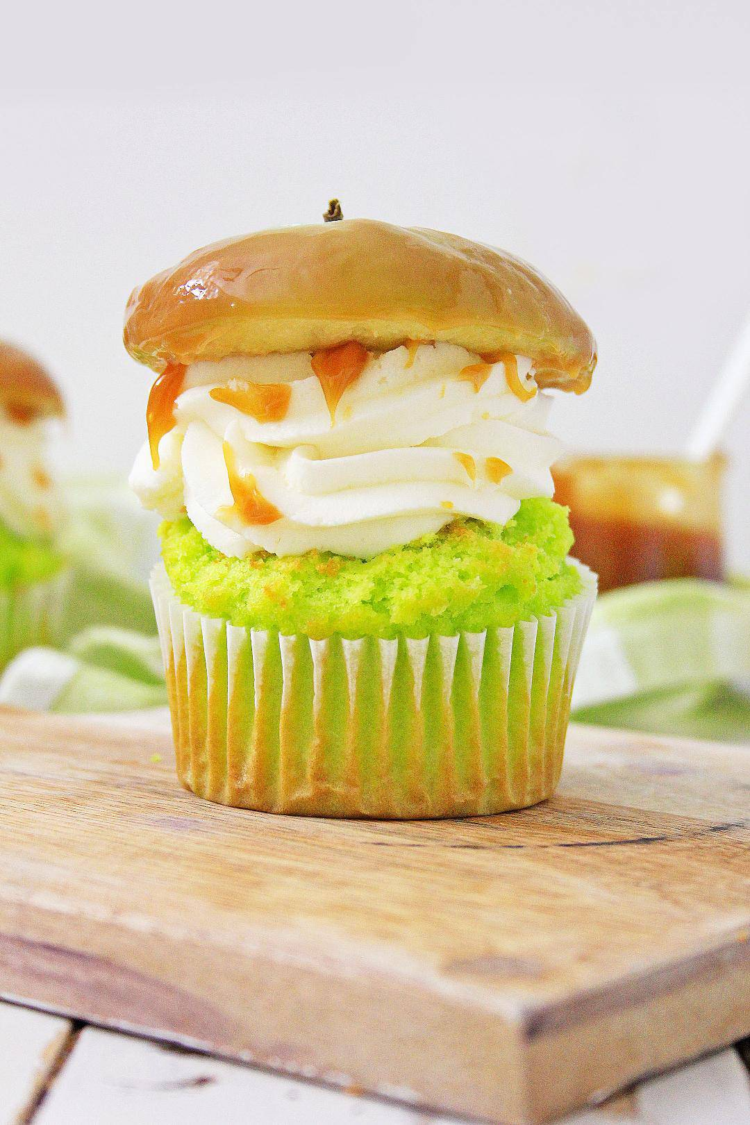 Delicious caramel apple cupcake on cutting board