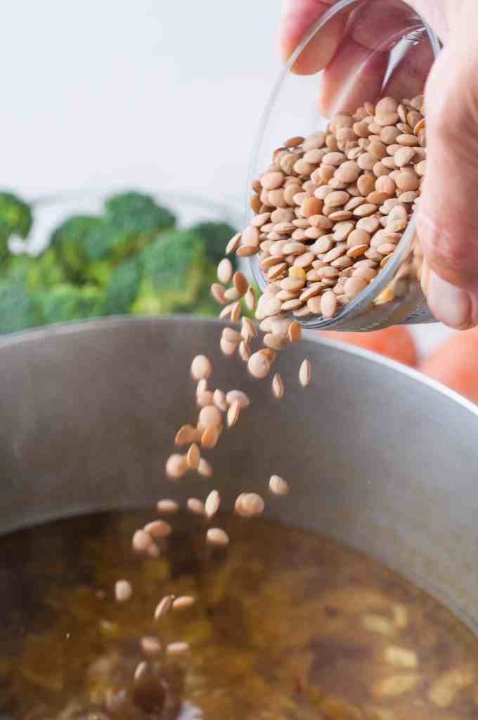 Lentils being poured into a pot