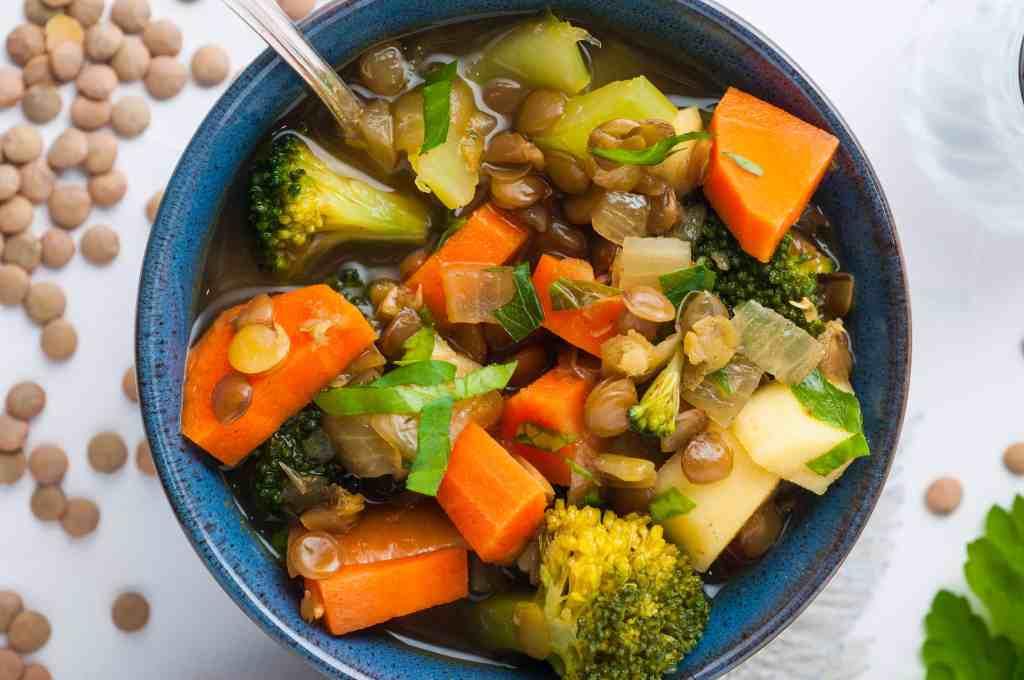 vegan lentil soup in a blue bowl.