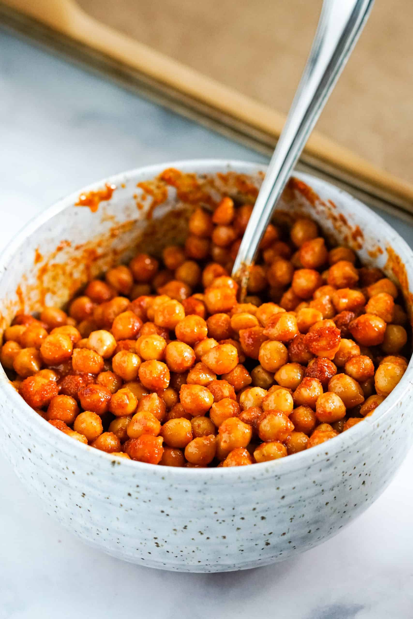 chickpeas coated with buffalo sauce.