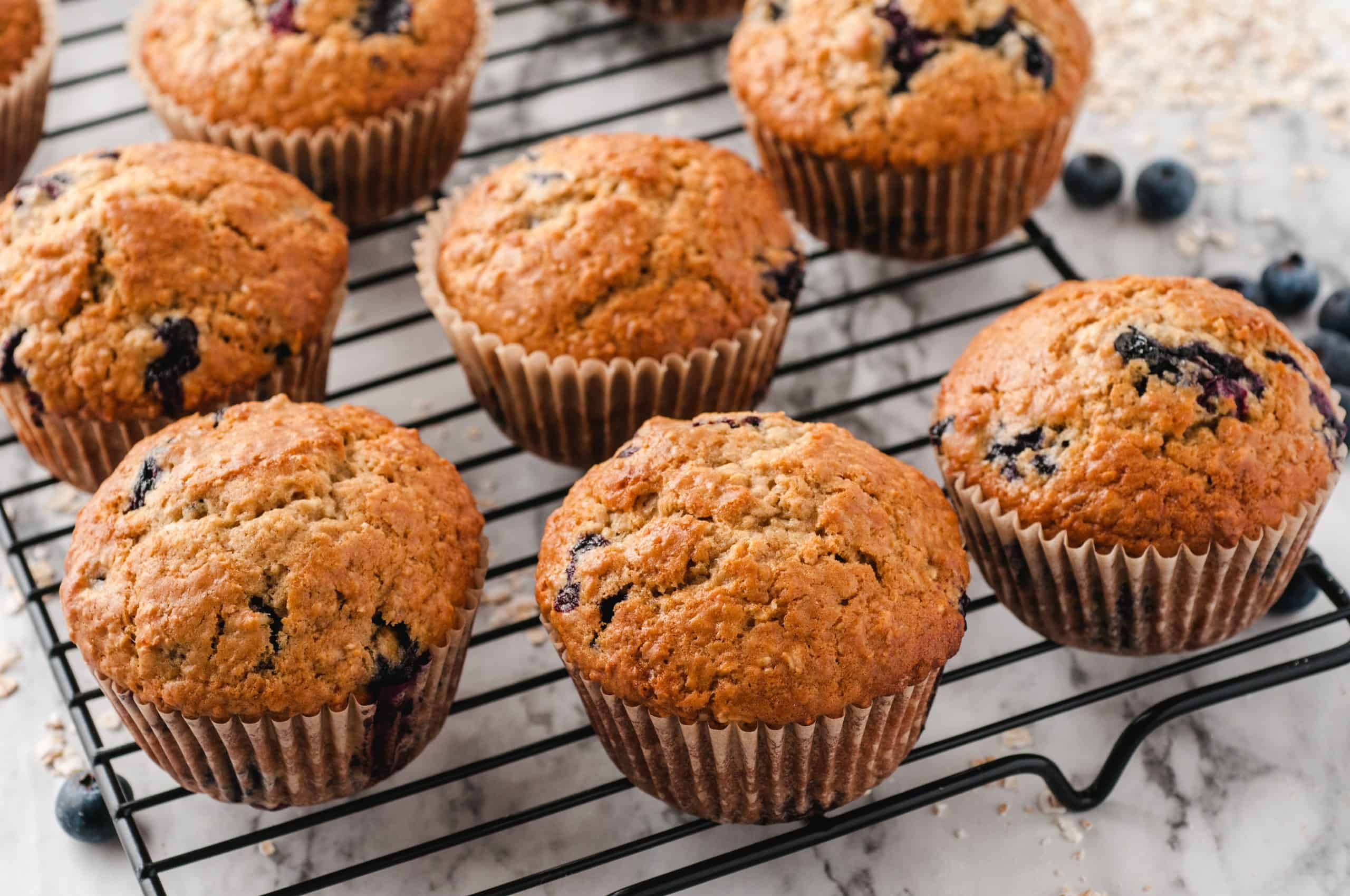 Fresh baked blueberry muffins on a wire rack.