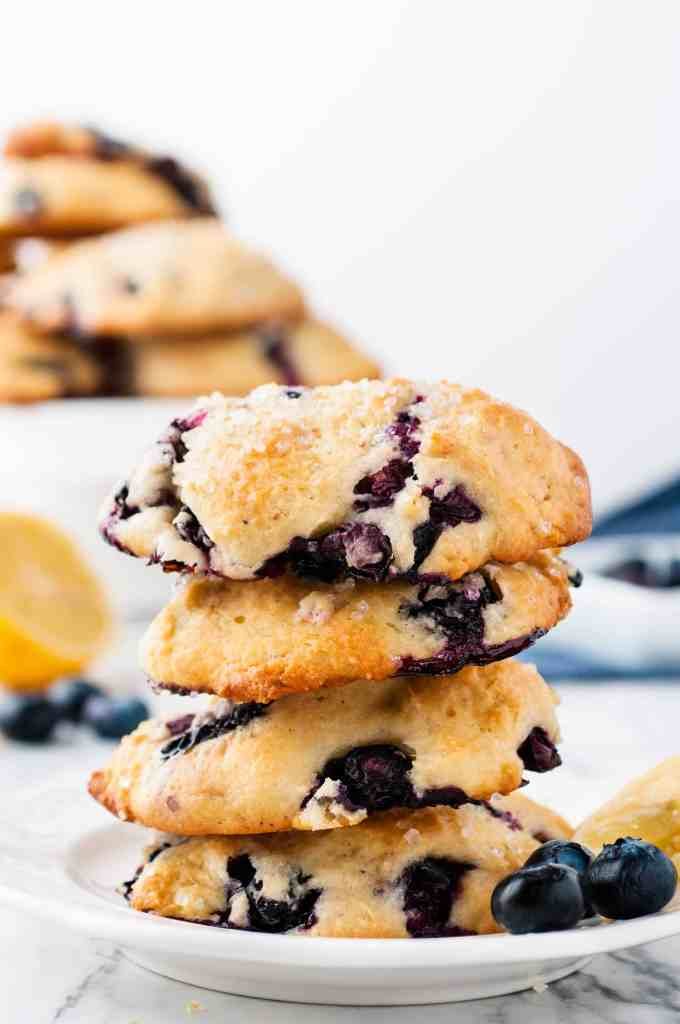 Stacked blueberry scones on a white plate.