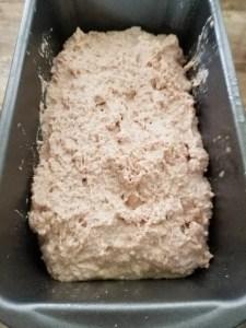 bread batter in a loaf pan