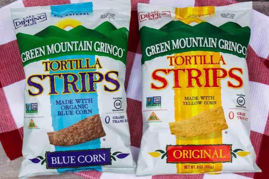 Overhead shot of bags of Green Mountain Gringo blue corn and original tortillas strips.