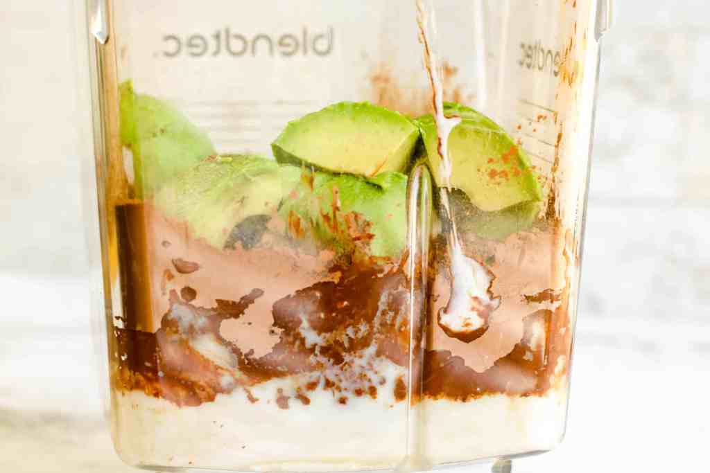 chocolate avocado ice cream ingredients in a blender.