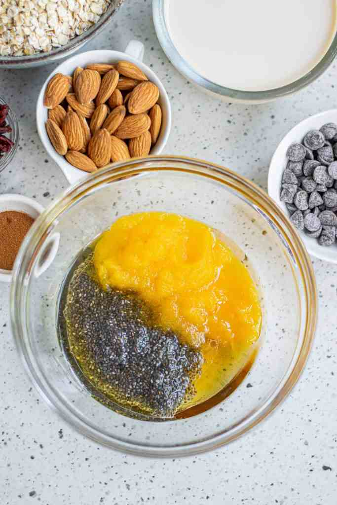 Chia seeds and pumpkin purée in a mixing bowl.