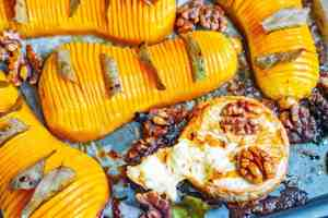 Overhead view of hasselback style roasted butternut squash with baked brie.