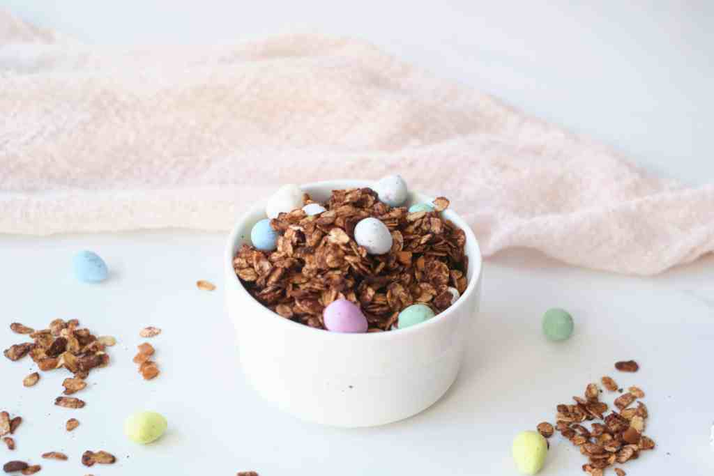 Homemade chocolate granola in a white bowl.