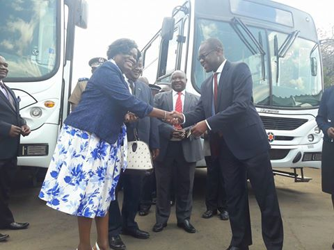 LUANAR and MUST officials receiving the Cashgate buses from Minister of Justice