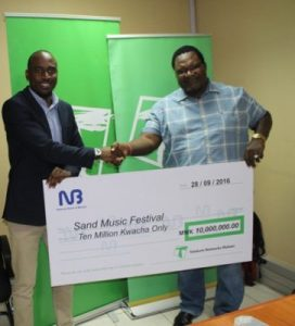Always with you: Jonazi presenting a cheque to lucius during the unveiling of sponsorship