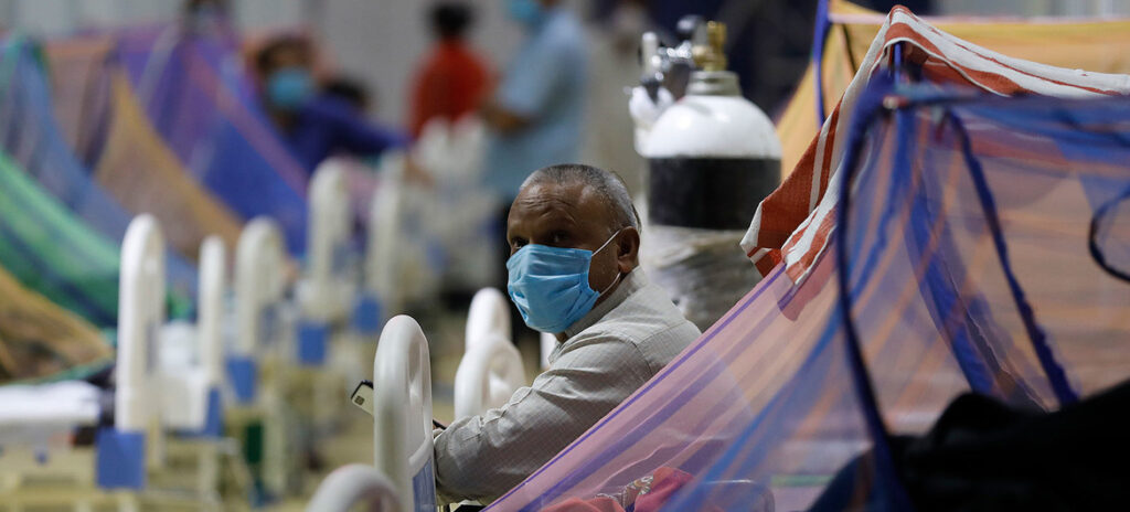 Patients receive treatment in the COVID-19 care centre at the Commonwealth Games Village (CWG) in New Delhi, India.