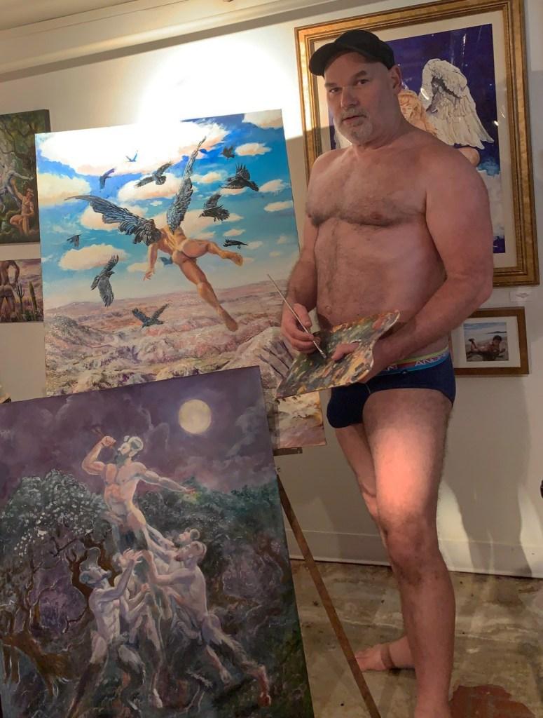 Photo of artist Marc DeBauch standing in his studio.