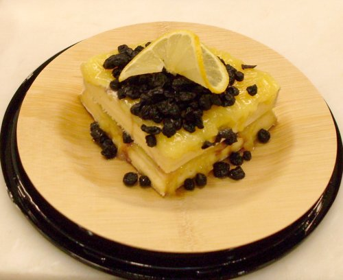 Brie de Nangis topped with Lemon Curd and Dried Blueberries
