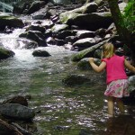 child at stream