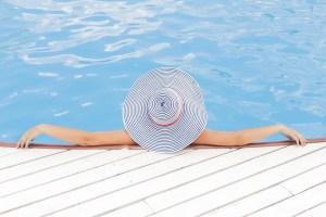 woman relaxing beside pool
