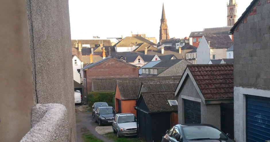 new mews house as seen from the other end of the lane; spires of the churches of Bangor with roofscape in the background