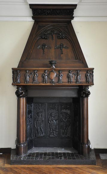 Monumental antique NeoGothic style fireplace with hood made out of carved walnut and courtly