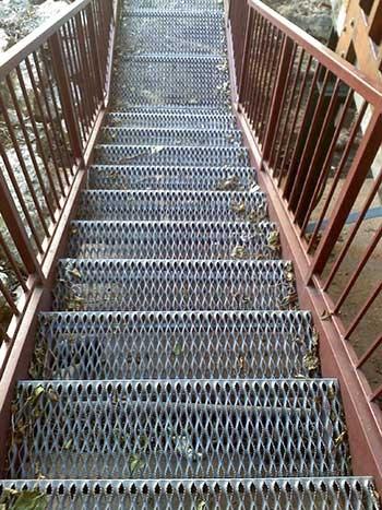 Metal Stair Tread Fabrication Grate Stair Treads Marco | Used Steel Stairs For Sale | Seawall | Exterior | Hinged | Black Metal | Industrial