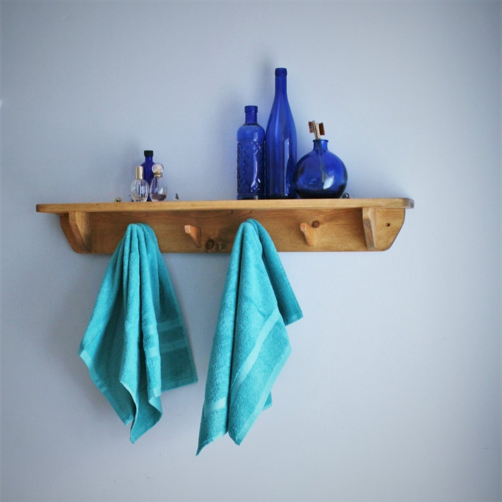 Designed and handmade in Somerset by Marc wood Joinery our solid wooden shelf is deep enough for bathroom towels and bathroom jars and cosmetic containers. For eco-friendly versatile storage in your modern rustic bathroom we use natural reclaimed wood and sustainable wood; the coat hanger hooks are upcycled and will hold your bathroom towels, washbags and dressing gown. Update your bathroom space with our solid wooden bathroom storage and furniture range, inbuilt storage avoidable and we can install near Somerset, Bath, Bristol, Dorset, Wiltshire and Devon.