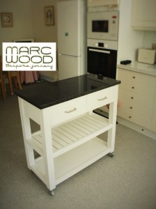 Custom handmade by Marc Wood Joinery in Somerset UK, our granite top, white painted kitchen furniture can be made to fit any awkward space. With 2 drawers and 2 shelves this kitchen storage calssic is a very useful addition to your modern rustic home.