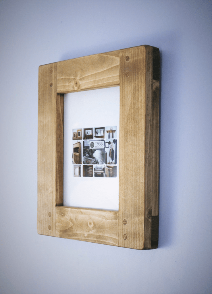 Handmade by Marc Wood Joinery in Somerset UK, this large picture frame in reclaimed wood and sustainable FSC timbers will hold a 8 x 10 inch image but can be made to any size.