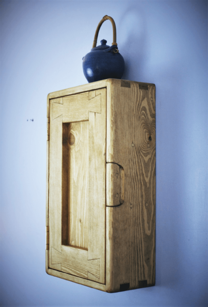 Our modern rustic custom handmade single wooden door kitchen wall cabinet measures 50 cm height X 30 cm width and 14 cm deep, with 3 shelves and has been inspired by traditional west country farmhouse country kitchens. Our vintage design is premium handmade by Marc Wood Joinery in Somerset UK from eco sustainable and reclaimed wood. Our tall and narrow artisan kitchen storage cabinet can be custom made to any size and we can arrange delivery or installation near Somerset, Dorset, Devon, Bristol or Exeter.