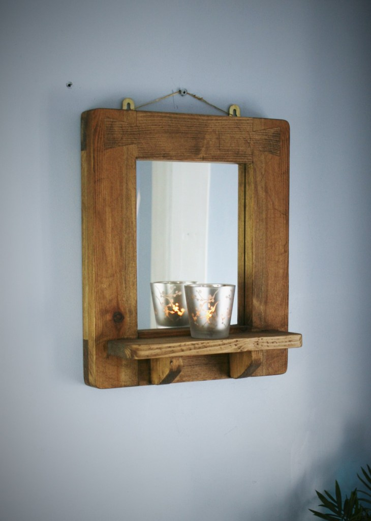 Small wooden frame wall mirror with shelf