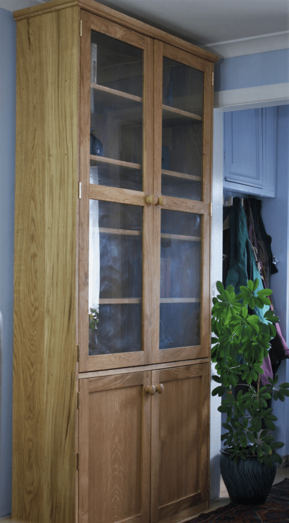 Tall wooden Oak bookshelves and bookcase with glass doors,