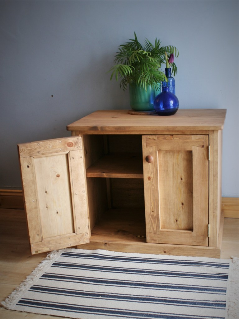 Wooden aquarium cabinet fish tank stand with strong storage shelf and rustic industrial double doors, here seen open
