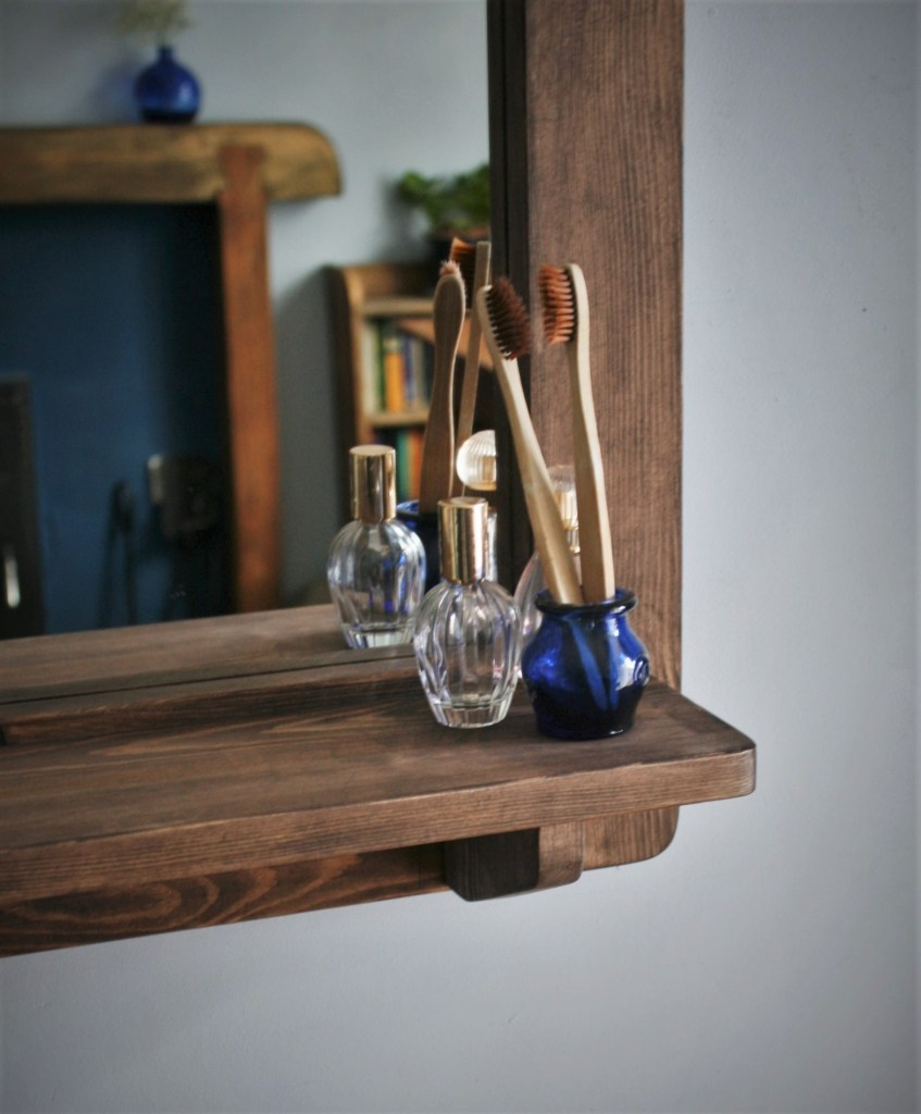 Detail of our large portrait wooden frame mirror with shelf