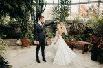 bride and groom dancing in green house in toronto, ontario