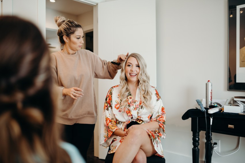 bride having her hair done for intimate wedding in toronto, ontario
