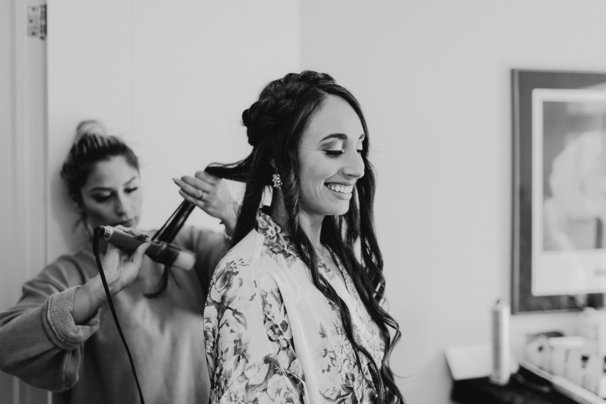 bridesmaid having her hair done for intimate wedding in toronto, ontario