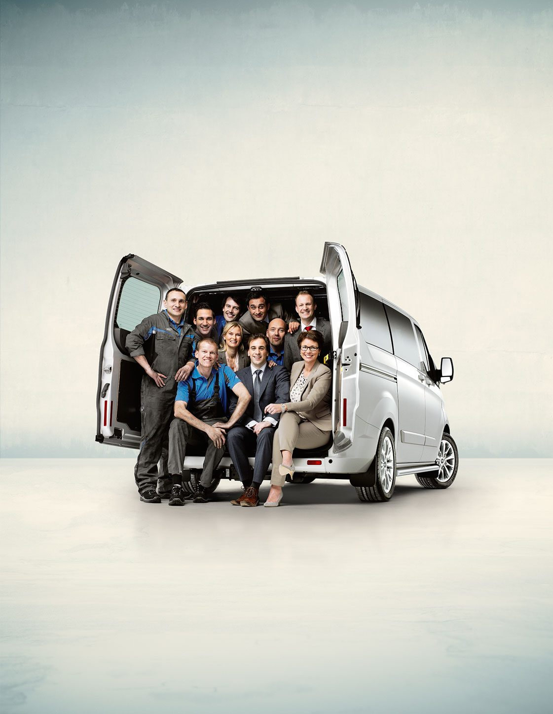 Ford; transit; team; people; sales; mechanics; grey; car; studio; Amsterdam; The Netherlands; booth; trunk; loading; cargo; luguage; verkoop; grijs; monteurs; bestel; auto; laden; laadruimte, van, bestelbus