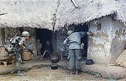 U.S. soldiers searching a village for NLF
