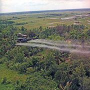 U.S. helicopter spraying chemical defoliants in the Mekong Delta, South Vietnam