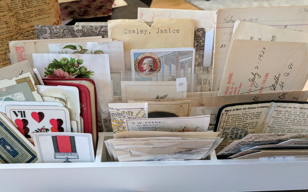 a container of vintage papers on display
