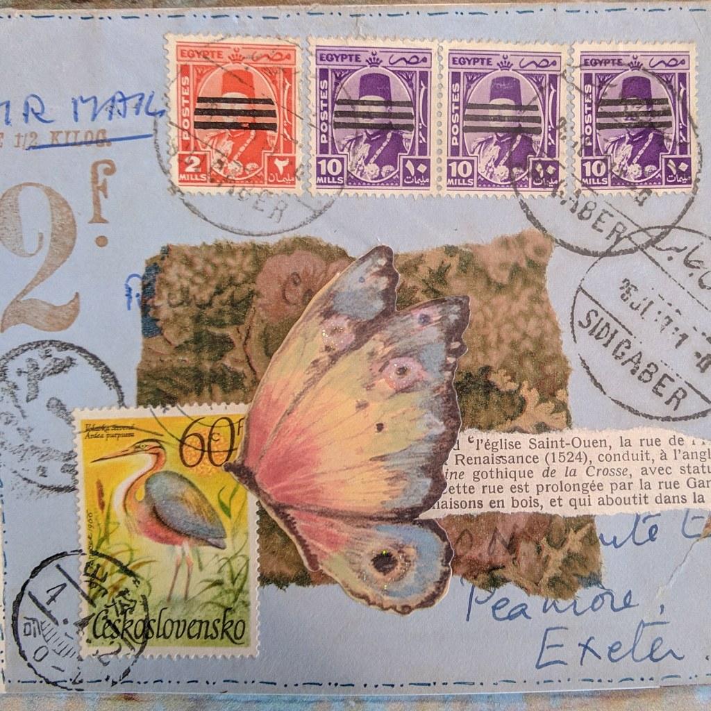 a vintage collage over a light blue envelope