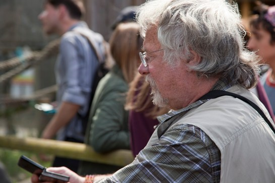 Photo of Bill Oddie at the zoo looking at animals